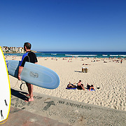 Bondi Beach surfers on a clear summer day. With copy space