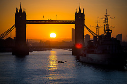 © Licensed to London News Pictures. 16/02/2016. London, UK. Sunrise behind Tower Bridge in central London on a cold winter morning. Temperatures in the capital dropped below zero last night. Photo credit: Ben Cawthra/LNP