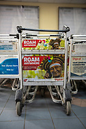 An advertisement for Digicel, a mobile phone network provider, is seen on an airport luggage cart in Port Moresby, Papua New Guinea. (August 12, 2017)