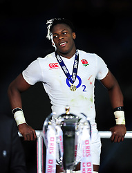 Maro Itoje of England looks on on the winners' podium after the match - Mandatory byline: Patrick Khachfe/JMP - 07966 386802 - 19/03/2016 - RUGBY UNION - Stade de France - Paris, France - France v England - RBS Six Nations.