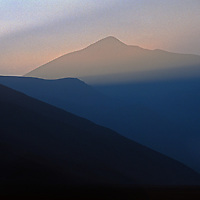 The sun rises over Volcan Socompa, a dormant volcano on the vast Altiplano of northern Argentina.