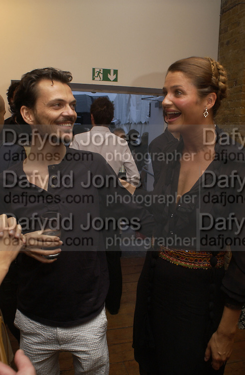 Matthew Williamson and Helena Christensen. Helena Christensen: An Eye For Beauty - private view. Sony Ericsson Proud Camden, Stables Market, The Gin House, London, NW1. 1 September 2005. ONE TIME USE ONLY - DO NOT ARCHIVE  © Copyright Photograph by Dafydd Jones 66 Stockwell Park Rd. London SW9 0DA Tel 020 7733 0108 www.dafjones.com