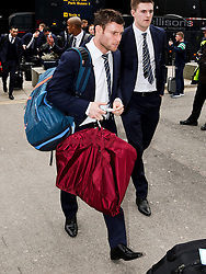 Manchester City's James Milner arrives at Manchester Airport to board the team flight to Barcelona ahead of the UEFA Champions League second leg match against Barcelona - Photo mandatory by-line: Matt McNulty/JMP - Mobile: 07966 386802 - 17/03/2015 - SPORT - Football - Manchester - Manchester Airport - Barcelona v Manchester City - UEFA Champions League