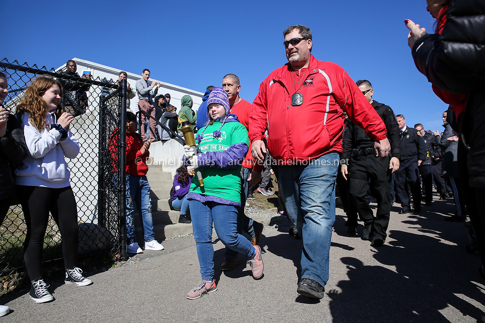 (4/11/19, MILFORD, MA) Milford High senior Kelsie Dues leads the march during the annual Unified School Day Games at Milford High School on Thursday. [Daily News and Wicked Local Photo/Dan Holmes]