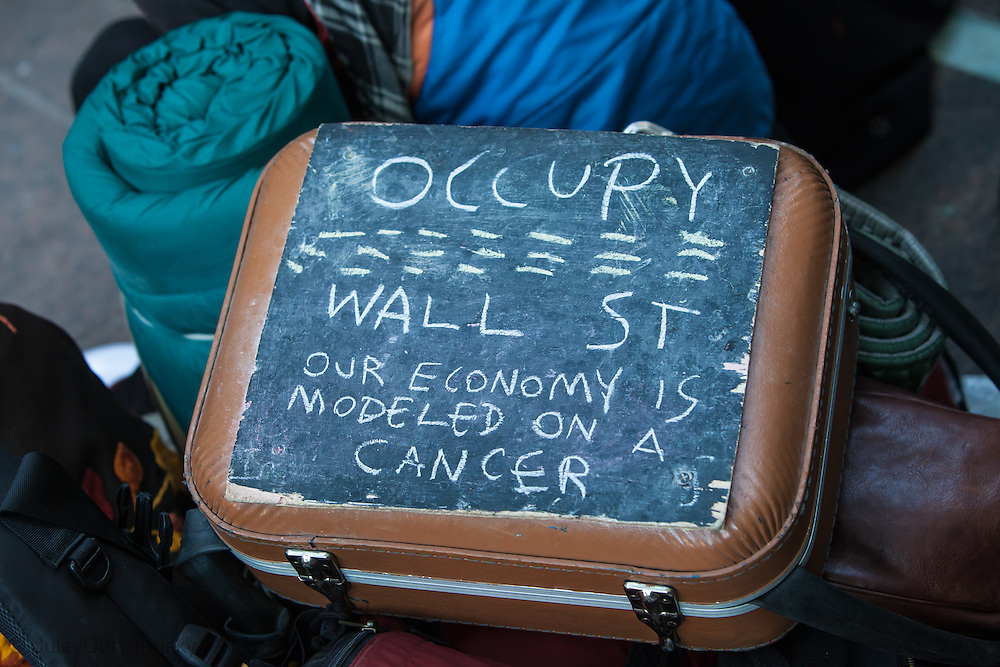 The protestors are fighting for social and economic justice.///<br /> October 4, 2011 in New York City, a suitcase  on top of protestors with a message with belongings from  protester in the Occupy Wall Street movement who have made an encampment in Zuccotti Park .
