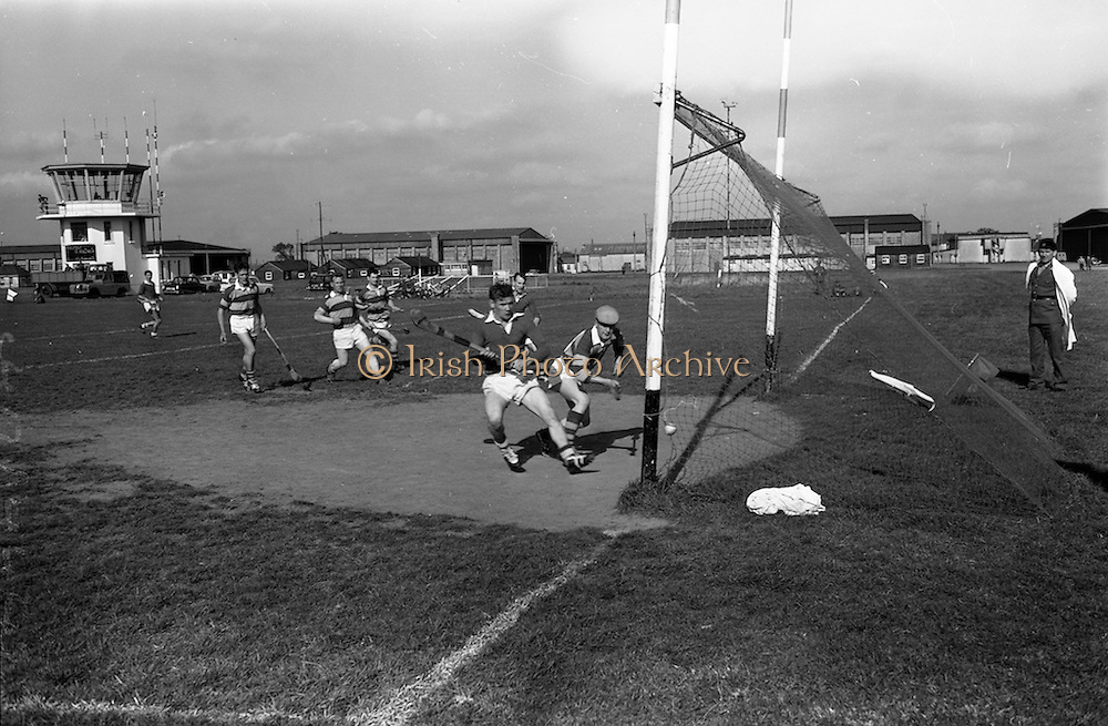 30/09/1964<br /> 09/30/1964<br /> 30 September 1964<br /> Air Corps v Southern Command at Baldonnel.<br /> Air Corps goalie J. Noonan was too late to stop the Southern Command forward from scoring.