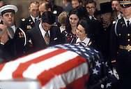 A 27MG IMAGE OF:..Lady Bird Johnson Lynda Bird and Chuck Robb at the head of the LBJ coffin as it lays in state in the LBJ Library during  the  funeral of  President Johnson in March 1973...Photgraph by Dennis Brack BS B13