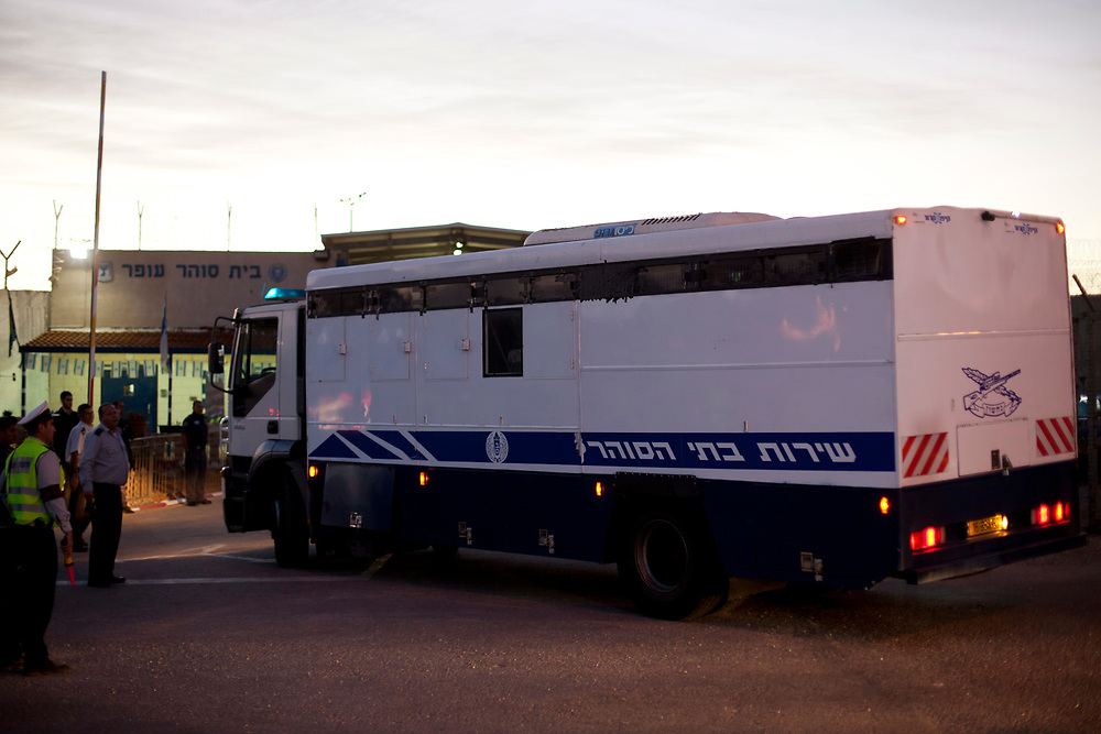 A convoy of Israeli Prison Service buses carrying Palestinians prisoners who are to be exchanged for  captive Israel Defense Forces soldier Gilad Shalit, arrive at Israel's Ofer prison, between Jerusalem and Ramallah, on October 18, 2011. A high-profile prisoner swap which will see the release of captive Israel Defense Forces soldier Gilad Shalit began before dawn on Tuesday. Shalit is to be freed after more than 5 years of captivity in Gaza in an exchange deal which will see the release of 477 Palestinian prisoners in an initial deal with another 550 to freed after the return of Shalit.