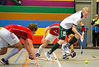 ARNHEM - Jochem Bakker van R'dam tegen Hurley. , De mannen van Rotterdam tijdens de eerste dag van de zaalhockey competitie in de hoofdklasse, seizoen 2013/2014. COPYRIGHT KOEN SUYK