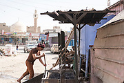 """Mcc0081437 . Daily Telegraph<br /> <br /> DT Foreign<br /> <br /> Street scenes in Marib, Yemen . <br /> <br /> Thanks to oil revenues and close ties with Saudi Arabia Marib could be viewed almost as an oasis of normalcy in a country torn apart by civil war . Since the conflict began in 2015 the town has expanded dramatically with Yemeni's flooding in from Houthi controlled areas attracted by the relative peace and stability .<br /> <br /> Yemen has been in the midst of a civil war since 2015 when the President Abdrabbuh Mansur Hadi was forced to flee . A Saudi led coalition with 9 other Arab states  named """"Operation Decisive Storm """"  has since sought to restore Hadi with little effect .<br /> <br /> Yemen 20 February"""