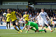 Burton Albion defender Kyle McFadzean (5) clears a cross for Leeds United striker Chris Wood (9) during the EFL Sky Bet Championship match between Burton Albion and Leeds United at the Pirelli Stadium, Burton upon Trent, England on 22 April 2017. Photo by Richard Holmes.