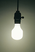 illuminated energy savings light bulb in a dark room