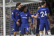 Marcos Alonso, Willian Borges, Gary Cahill and Davide Zappacosta of Chelsea celebrate with Willian of Chelsea © after he scores his teams 4th goal from a penalty. <br /> Premier league match, Chelsea v Stoke city at Stamford Bridge in London on Saturday 30th December 2017.<br /> pic by Kieran Clarke, Andrew Orchard sports photography.