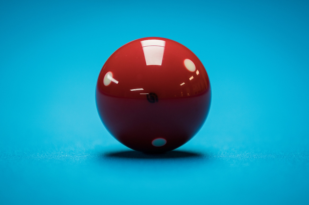 The red object ball lies on a table at Three Cushion Billiards in Madison, WI on Friday, May 10, 2019.
