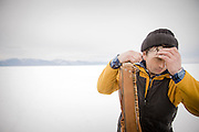 Ice Fisherman, Lake Baikal. Siberia, Russia