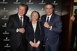 On 25th April 2014 in London at the Hublot Boutique in New Bond Street, Ricardo Guadalupe, CEO of Hublot, presented Roy Hodgson, the Manager of the England National football team, with a watch that has been created and named in his honour. The Hublot King Power 66 Hodgson is a Limited Edition of 66 pieces to commemorate the year that England won the World Cup. The idea was hatched from Roy's son Christopher who also collaborated with Hublot on the design of this amazing piece. The presentation was followed by a tour and a dinner at the House of Commons that was attended by Hublot VIP customers.<br /> <br /> PICTURE SHOWS:- Roy Hodgson, the Manager of the England National football team, his wife Sheila Hodgson and Ricardo Guadalupe, CEO of Hublot.