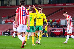 Goalscorer Emi Buendia of Norwich City high fives team mate Josh Martin - Mandatory by-line: Nick Browning/JMP - 24/11/2020 - FOOTBALL - Bet365 Stadium - Stoke-on-Trent, England - Stoke City v Norwich City - Sky Bet Championship