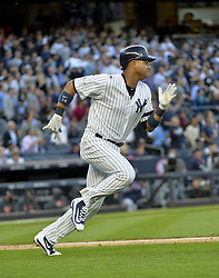 October 18, 2017 - Bronx, NY, USA - The New York Yankees' Starlin Castro doubles in the second inning against the Houston Astros in Game 5 of the American League Championship Series at Yankee Stadium in New York on Wednesday, Oct. 18, 2017. (Credit Image: © Howard Simmons/TNS via ZUMA Wire)