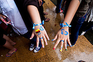 Pupils show their hands painted with their class numbers during an academic competition at Chu Van An School, Hanoi, Vietnam