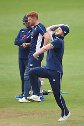 England head coach Trevor Bayliss talks to Jonny Bairstow as Ben Stokes bowls during the nets session at Cardiff Wales Stadium.