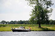 Nederland, Batenburg, 4-8-2012Varen op de rivier de Maas. Een kleine motorkruiser.Foto: Flip Franssen/Hollandse Hoogte