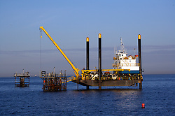 Stock photo of a jack up rig on the ocean