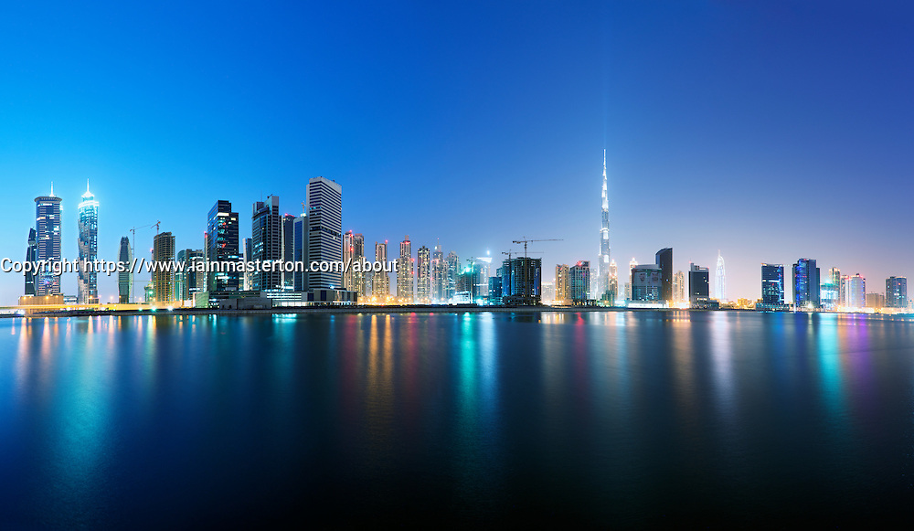 Evening view of new Business Bay under construction in Dubai United Arab Emirates
