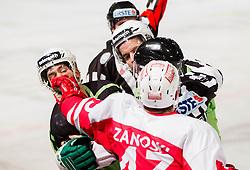08.01.2012, Stadium Bezigrad, Ljubljana, SLO, EBEL, HDD Telemach Olimpija Ljubljana vs KAC Klagenfurt 40. Runde, in picture fight between  Tom Zanoski of KAC and Kevin De Vergilio (HDD Telemach Olimpija, #51) and Brock McBride (HDD Telemach Olimpija, #10) during the Erste Bank Ice Hockey League in 40th Round match between HDD Telemach Olimpija Ljubljana and KAC Klagenfurt at the open ice winter classic Stadium Bezigrad, Ljubljana, Slovenia on 2013/01/08. (Photo By Vid Ponikvar / Sportida.com)