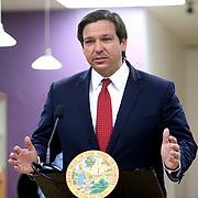 Florida Governor Ron DeSantis discusses how to safely reopen Florida salons with small business owners during a roundtable at OhSoooJazzy Hair Salon in Orlando, Florida on Saturday, May 2, 2020. (Alex Menendez via AP)