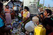Local women are busy collecting supposedly safe drinking water from a few public water tanks located around the abandoned Union Carbide (now DOW Chemical) industrial complex in Bhopal, Madhya Pradesh, India.
