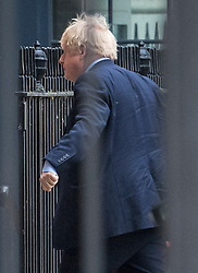 © Licensed to London News Pictures. 17/05/2021. London, UK. British Prime Minister BORIS JOHNSON is seen returning to Downing Street. From today, lockdown rules are easing with pubs and restaurants able to serve customers indoors, and social distancing guidelines relaxed. Photo credit: Ben Cawthra/LNP