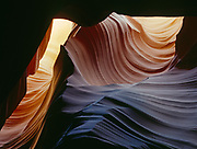 Sweeping wall of water-carved sandstone within a slickrock slot canyon, Colorado Plateau, Arizona.  UPW