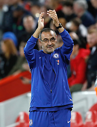Chelsea manager Maurizio Sarri applauds the fans after the final whistle of the Carabao Cup, Third Round match at Anfield, Liverpool.