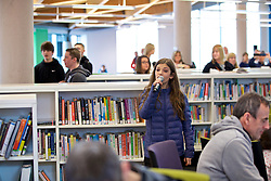 CARDIFF, ENGLAND - Tuesday, February 21, 2017: A flash mob choir in Cardiff Library sing the Champions League anthem The Prayer to promote the men's and women's UEFA Champions League Finals being staged in Cardiff this June. (Pic by Paul Greenwood/Propaganda)
