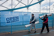 Open As Usual: Workmen carry items at the start of repairs to Londons Tower Bridge, on 10th October 2016, in London, England. Closed for repairs to traffic and disrupting this major Thames crossing and surrounding roads for the next three months.