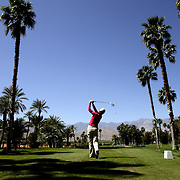 A player tees off at the Mission Hills Country Club during the Kraft Nabisco Championship in Rancho Mirage, California.
