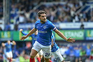 Portsmouth Midfielder, Gareth Evans (26) scores a goal to make it 1-0 and turns to celebrate during the EFL Sky Bet League 1 match between Portsmouth and Oxford United at Fratton Park, Portsmouth, England on 18 August 2018.
