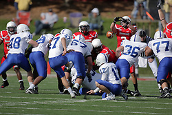 17 October 2009: Casey Kociuba leaps in an attempt to block a field goal attempt by Gabe Mullane. The Indiana State Sycamores tumble to the Illinois State Redbirds 38-21 at Hancock Stadium on campus of Illinois State University in Normal Illinois