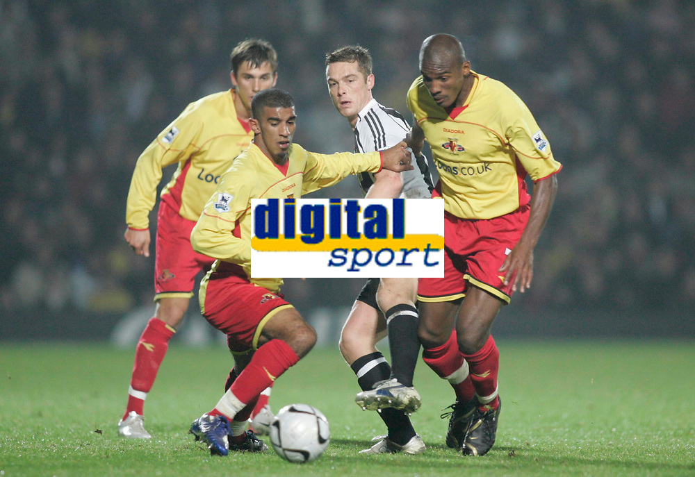Photo: Marc Atkins.<br /> Watford v Newcastle United. Carling Cup. 07/11/2006.<br /> Hameur Bouazza (L) & Damein Francis of Watford in action with Scott Parker of Newcastle.