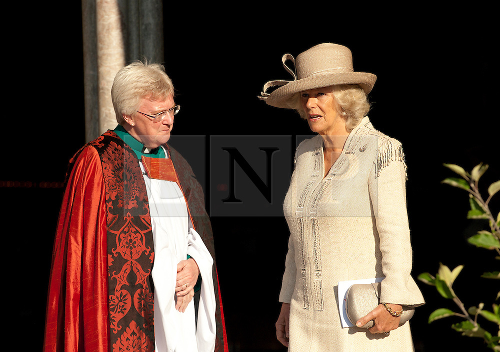 © Licensed to London News Pictures. 02/10/11..Salisbury Cathedral, Salisbury, Wiltshire...HRH The Duchess of Cornwall attended a memorial service at Salisbury Cathedral to mark ten years in Afghanistan pictured here with the Very Reverend June Osborne, the Dean of Salisbury Cathedral...The service, called 'Light for Life' saw candles lit for servicemen and women who have been killed during the British involvement in Afghanistan. On the approach to the Cathedral a line of trees represented all those Regiments that have lost soldiers through the campaign...The event was organised by the charity - Dec Aid - who have been raising money throughout the year to support service charities.. .Photo credit : Ian Forsyth/LNP