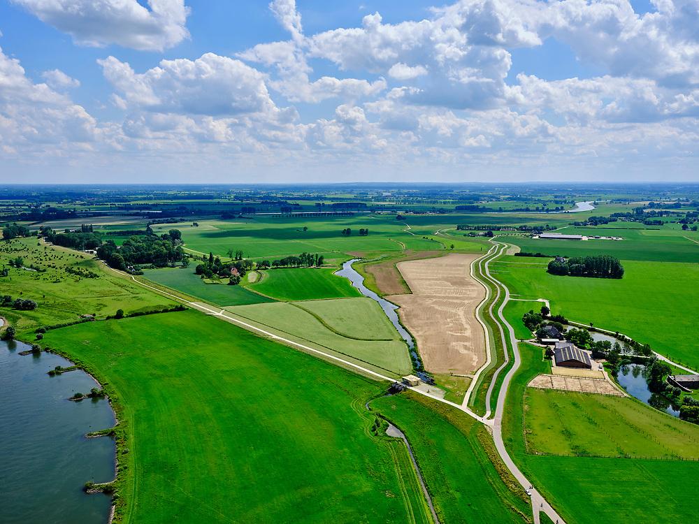 Nederland, Gelderland, Gemeente Brummen, 21–06-2020; rivier de IJssel, dijkverlegging Cortenoever. De Brummense Bandijk (winterdijk) is verlaagd en heeft een uitstroom-openingen gekregen en er is een nieuwe dijk aangelegd, meer landinwaarts. Het gebied tussen oude en nieuwe dijk is meestroom-gebied in geval van hoog water. Gemaal voor de waterhuishouding van het gebied.<br /> Shifting the Cortenoever dike. A new (secondary) dike has been build, more landinward, the existing dike has been reduced in height to the to create exit opening. The area between old and new dike will flood in case of high water.<br /> <br /> luchtfoto (toeslag op standaard tarieven);<br /> aerial photo (additional fee required)<br /> copyright © 2020 foto/photo Siebe Swart
