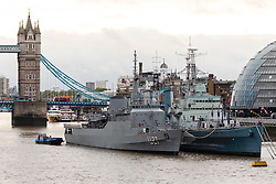© Licensed to London News Pictures. 16/10/2019. London, UK. Brazilian naval warship, NE Brasil moored next to HMS Belfast in front of Tower Bridge on the River Thames during a London visit. NE Brasil arrived yesterday and will stay until 20th October. Environmental campaign groups are challenging the increasing numbers of large warships, cruise ships and super yachts visiting the capital because of the pollution they create. Photo credit: Vickie Flores/LNP