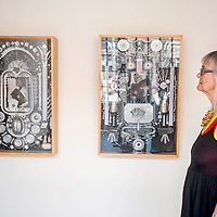 """080713       Cable Hoover<br /> <br /> Mixed-media artist Ann Dunbar stands back for a look as she hangs her show """" Mix and Match"""" at Crashing Thunder Gallery in downtown Gallup Wednesday."""