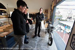 Harley-Davidson's (L>R) Ben McGinley, Dais Nagao and Head of design Ray Drea check out the Deus Ex Machina new Tokyo store 3-days after its grand opening. Tokyo. Japan. Wednesday, December 10, 2014. Photograph ©2014 Michael Lichter.
