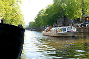 """The canals of Amsterdam were mainly built during the Dutch Golden Age, and have led the city to being termed the """"Venice of the North"""" The best way to see them is with a special Canal Boat, that fits through the sometimes narrow canals"""
