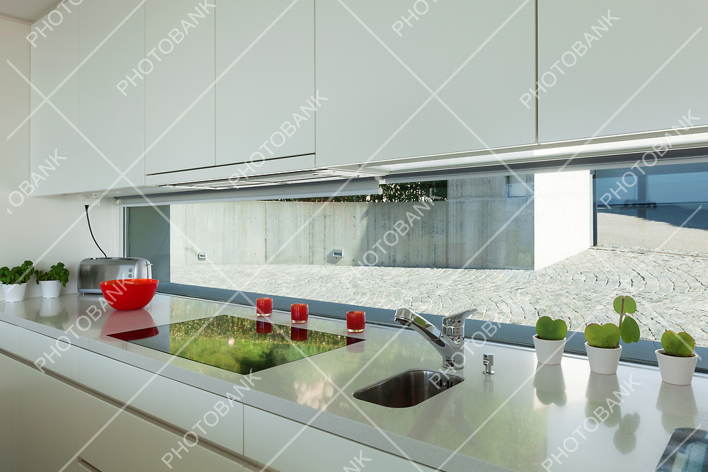 Interior of a modern house, stove top of the domestic kitchen