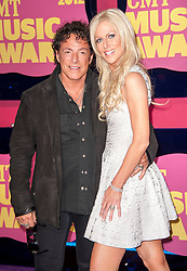Jun 6, 2012 - Nashville, Tennessee; USA - Guitarist NEAL SCHON of the band Journey and his girlfriend MICHAELE SALAHI arrives on the purple carpet at the 2012 CMT Music Awards that is taking place at the Bridgestone Arena located in downtown Nashville.  Copyright 2012 Jason Moore. (Credit Image: © Jason Moore/ZUMAPRESS.com)