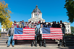 Group photo in front of the state capital in Pierre during a stop for the USS South Dakota submarine flag relay across South Dakota on the first day from Sturgis to Aberdeen. SD. USA. Saturday October 7, 2017. Photography ©2017 Michael Lichter.