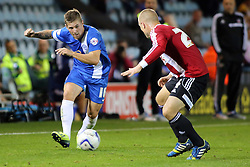 Peterborough United's Daniel Kearns takes on Brentford's Jake Bidwell - Photo mandatory by-line: Joe Dent/JMP - Tel: Mobile: 07966 386802 08/10/2013 - SPORT - FOOTBALL - London Road Stadium - Peterborough - Peterborough United V Brentford - Johnstone's Paint Trophy