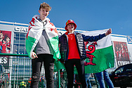 Two Wales fans outside the ground ahead of the UEFA European 2020 Qualifier match between Wales and Slovakia at the Cardiff City Stadium, Cardiff, Wales on 24 March 2019.